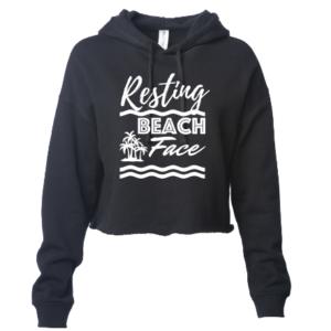 Crop top hoodie resting beach face black